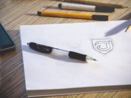 pen and logo on paper